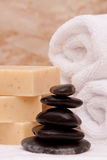 Lastone therapy rocks. Stack of lastone therapy rocks with towels and soap Stock Photography
