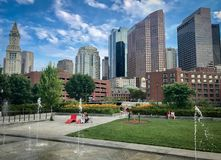 Boston skyline from one of the city parks. In the lasts weeks of the summer, the cold starts to fill the city on a sunny day royalty free stock photos