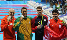 Laszlo Cseh hun, Czad Le Clos RSA i Joseph Uczy kogoś SGP podczas medal ceremonii, Michael Phelps usa (L) Fotografia Stock