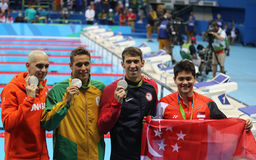 Laszlo Cseh HUN L, Chad le Clos RSA , Michael Phelps USA and Joseph Schooling SGP after Men`s 100m butterfly of the Rio 2016 Royalty Free Stock Photography