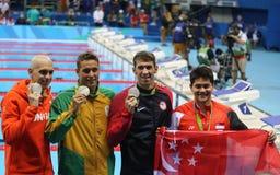 Laszlo Cseh-HUNNE L, Chad le Clos RSA, Michael Phelps USA und Joseph Schooling SGP nach Männer ` s 100m Schmetterling des Rios 20 lizenzfreie stockfotografie