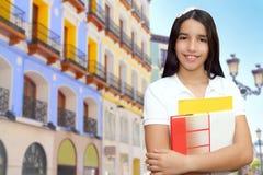 Latín adolescente de la chica joven triguena del estudiante Foto de archivo