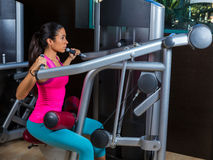 Lat Lateral dorsal pulldown machine upper back. Exercises woman at gym workout Stock Photo