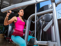 Lat Lateral dorsal pulldown machine upper back. Exercises woman at gym workout Stock Image