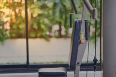 Lat pull-down gym machine is for compound exercises, working the royalty free stock photography