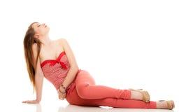 lata mody Nastoletnia dziewczyna w czerwonym stroju odizolowywającym obraz stock