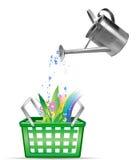 Lata molhando e flores. Fotos de Stock Royalty Free