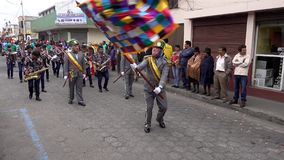 Latacunga, Ecuador - 20180925 - Clown Waves Flag in Mutter Negra Parade stock video footage