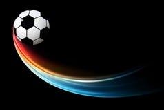 Latająca płomienna futbolu, piłki nożnej piłka z błękitnym płomieniem/ Obraz Royalty Free