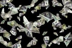 Latający dolary odizolowywający zdjęcie royalty free