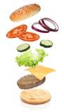 Latający składniki hamburger zdjęcia stock