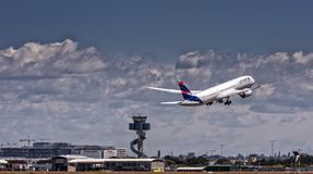 LATAM Boeing Dreamliner on takeoff. A LATAM airlines Boeing Dreamliner takes off from Sydney Airport, Australia enroute to Santiago, Chile via Auckland, New royalty free stock image