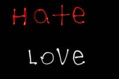 Latarki Writing miłość i nienawiść Obrazy Royalty Free