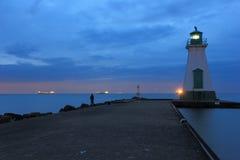 Latarni morskiej linia horyzontu i molo Zdjęcie Royalty Free