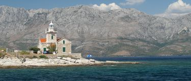Latarnia morska na południowej końcówka wyspa Hvar w Chorwacja Fotografia Stock
