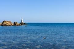 Latarnia morska na skałach Fotografia Stock