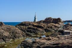 Latarnia morska na skałach Obrazy Stock