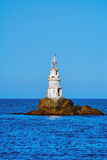 Latarnia morska w morzu Fotografia Royalty Free