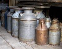 Latas antiguas de la leche Fotografía de archivo libre de regalías