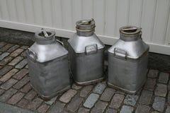 Latas de la leche Imagen de archivo libre de regalías