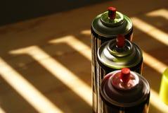 Latas de la pintura de espray Foto de archivo libre de regalías