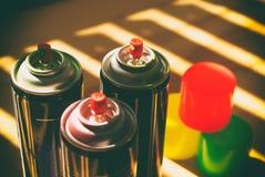 Latas de la pintura de espray Fotos de archivo libres de regalías