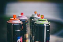 Latas de la pintura de espray Imagen de archivo libre de regalías