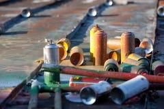 Latas de pulverizador usadas Fotos de Stock
