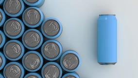Latas de soda azules grandes en el fondo blanco Imágenes de archivo libres de regalías