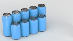 Latas de soda azules que se colocan en dos raws en el fondo blanco Imagen de archivo libre de regalías