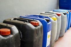 Latas llenadas producto químico Foto de archivo libre de regalías