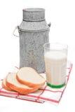 Latas, pão e um vidro do leite Fotografia de Stock