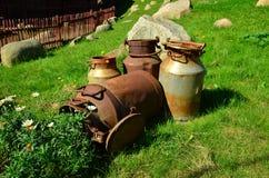 Latas viejas de la leche Imagen de archivo libre de regalías
