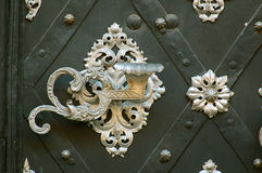Latch. Metallic latch of an ancient door in Praga Stock Photo