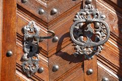 Latch and caller. Metallic latch and caller at the door of San Jorge Basilica  from the Castle of Prague Royalty Free Stock Image