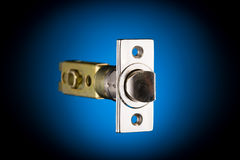 Latch mechanism isolated on blue and black Stock Photo
