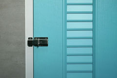 Latch on pastel door. Close up of latch on pastel door Stock Photos