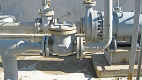 Latch on the pipeline. Oil refinery. Equipment for primary oil refining stock photos