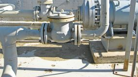 Latch on the pipeline. Oil refinery. Equipment for primary oil refining royalty free stock image