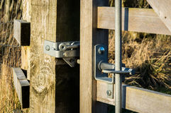 Latch on wooden gate Royalty Free Stock Image