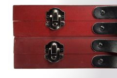 Latched boxes. Two wooden boxes w/ leather handles and metal hinges Stock Images