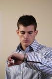 Late. A man checks his watch Royalty Free Stock Photos