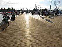 Late Afternoon at the Brand New Dock. Photo of people relaxing and walking on the new dock at the wharf at the southwest waterfront in washington dc on 10/14/17 royalty free stock photo
