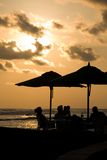 Late afternoon drinks. As the sun goes down over the Pacific, guests at an El Salvador resort enjoy their late afternoon drinks stock images