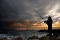 Late afternoon fishing. Royalty Free Stock Photography