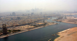 Late Afternoon Heat Haze Aerial View of Dubai City. Late Afternoon Heat Haze Aerial View of Dubai City and port area Royalty Free Stock Photo