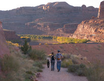 Late afternoon hike. A young couple and their dog return from an afternoon hike Royalty Free Stock Image