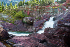 Late Afternoon on Redrock Trail. Cascading stream on Redrock Trail in east Glacier National Park, Montana royalty free stock image