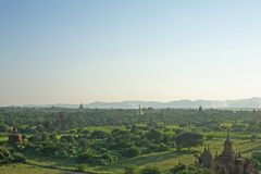 The late afternoon sun shines hazy over the temple plains of Bagan in Burma stock photo