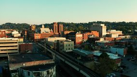 Late afternoon sunshine hits buildings and architecture in Morgantown WV. Morgantown West Virginia is situated on a steep hill above the Monongahela River stock video footage